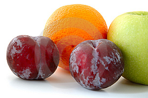 Apple, Orange And Plums. Stock Photography - Image: 5295902