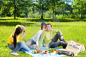Three friends at picnic making a photos Stock Photography