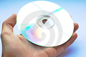 Handing CD Or DVD Over Royalty Free Stock Image - Image: 5334716