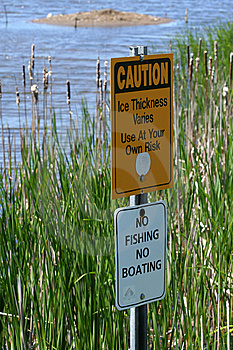 Warning Signs In Marsh Stock Photography - Image: 5337352