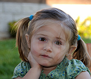 Little Girl With Pony Tails Listening Stock Image - Image: 5338081