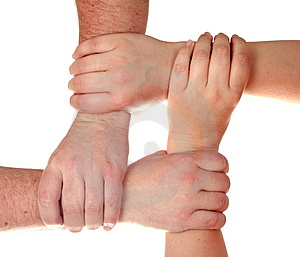Four hands holding Stock Images