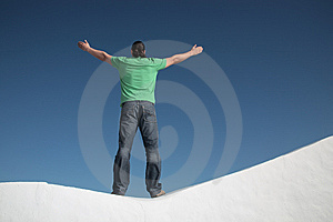 Young man with arms wide open Free Stock Photos