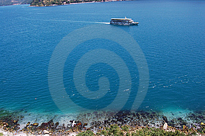 Lonely Boat Crusing On Blue Sea Stock Images - Image: 5362294