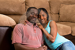 Couple Sitting Together By A Sofa- Horizontal