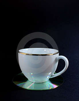 Cup On A CD Coaster Stock Photo - Image: 5369340
