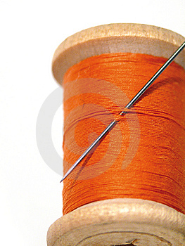 Sewing spool with a needle. A sewing needle. Royalty Free Stock Photos