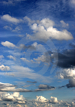 Clouds In A Bright Blue Sky Royalty Free Stock Photo - Image: 5392785
