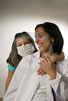 Girl Wearing a Doctor's Mask Hugs Doctor-Vertical Royalty Free Stock Photography