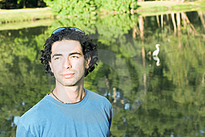 Man Standing In Front Of Pond - Horizontal Royalty Free Stock Image - Image: 5434156