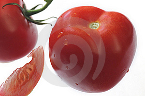 Tomato Close-up  With Slice Royalty Free Stock Photos - Image: 5447118