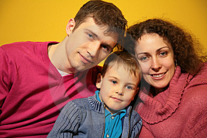 Family on yellow background Royalty Free Stock Photos