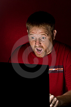 Notebook User Looking Astonished Royalty Free Stock Photo - Image: 5474175