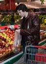 Man grocery shopping Royalty Free Stock Photo