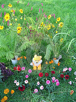 Toy Young Fox On A Flower Glade Royalty Free Stock Image - Image: 5482826