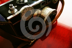 Vintage Camera On Cherry Desk Stock Images - Image: 558204