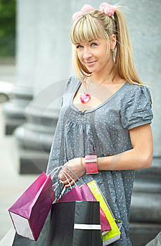 Beauty Shopping Girl With Packet Royalty Free Stock Image - Image: 5521026