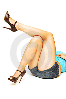 Nice Legs Laying On The Floor. Royalty Free Stock Images - Image: 5526559