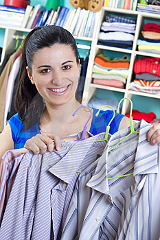 Housewife putting clothes on available space Royalty Free Stock Photo