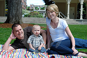 Family Lying Together in Grass - horizontal