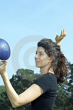 Woman Spiking Volleyball - Vertically Framed Shot. Royalty Free Stock Images - Image: 5570049