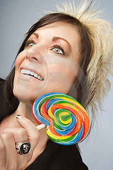 Creative Businesswoman With A Lollipop Royalty Free Stock Image - Image: 5575716