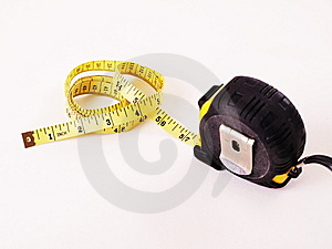 Floppy Measuring Tape Out Of Steel Measuring Tape Stock Photos - Image: 5577363