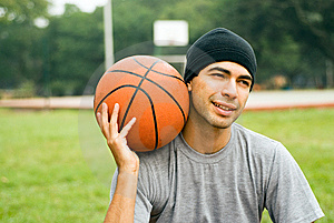 Man in Park Holding Basketball - Horizontal Stock Photos