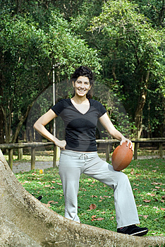 Woman Next To Tree Holding Football - Vertical Royalty Free Stock Image - Image: 5579626