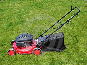 Lawn Mower In  Grass Stock Images - Image: 5599164