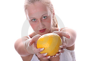 Woman Is Showing Grapefruit Royalty Free Stock Photography - Image: 5605687