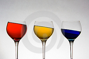 Wineglasses With Colored Liquid At Odd Angle Royalty Free Stock Photography - Image: 5608407