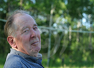 Elderly man enjoying outdoors Stock Image