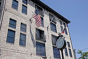 Street Clock And Lofts Royalty Free Stock Photography - Image: 5611587
