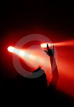 Fan shows devil sign Stock Photo