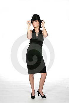 Slim Teen In Black Dress Wearing A Top Hat Royalty Free Stock Photography - Image: 5628287