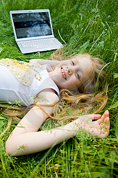 Smiling Little Girl With Laptop Outside Stock Photos - Image: 5632993