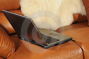 Laptop On A Sofa Royalty Free Stock Photos - Image: 5643508