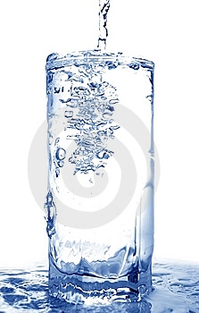 Water poured into glass Free Stock Photography