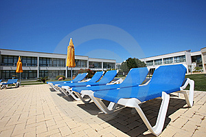 Several Sunbeds Royalty Free Stock Photos - Image: 5671518
