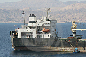 Cargo Ship And Pilot Boat Royalty Free Stock Image - Image: 5673936