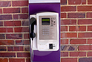 Phone On Brick Wall Stock Photo - Image: 5731900