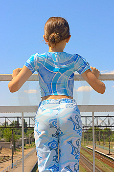 Teen Girl See On Train Rails Way On Sky Background Royalty Free Stock Image - Image: 5751766