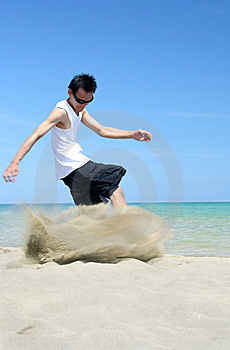 Kicking The Tropical Beach Sand Stock Photo - Image: 5752160