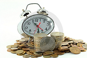 Coins And Hours-alarm Clocks Stock Photo - Image: 5759440