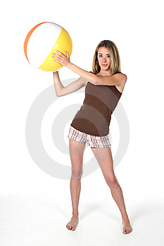 Fit And Slender Teen With Beach Ball Royalty Free Stock Images - Image: 5763179