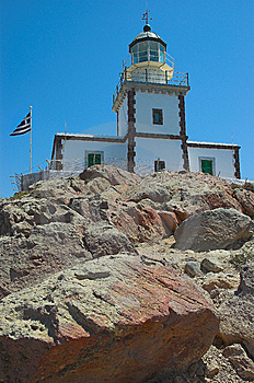 Lighthouse On The Rocks Stock Photography - Image: 5769572