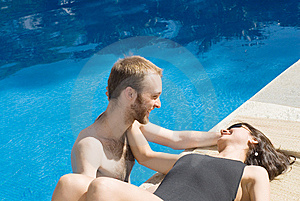 Couple Smiling Near And In Pool - Horizontal Royalty Free Stock Image - Image: 5791686