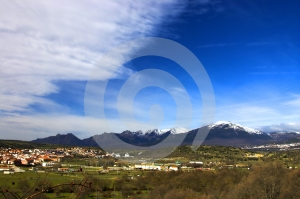 Mountains, Village And A Blue Sky Stock Photography - Image: 585942