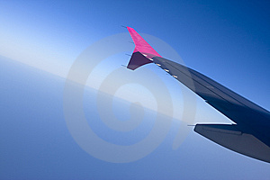 Aircraft Wing On A Blue Sky Royalty Free Stock Image - Image: 5822286